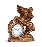 Antiquarian bronze clock on white. Sculpture with a horse the horseman and with hours a covering a bronze paint Stock Image