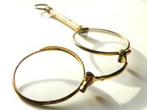 Antiquarian eyeglasses on a white background Royalty Free Stock Photography