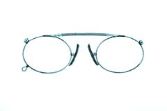 Antiquarian eyeglasses on a white background Stock Photography