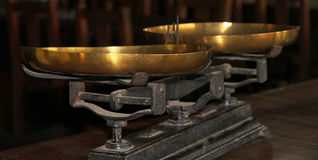 Antiquarian old scales with gold bowls. Balance. Stock Photo
