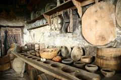 Antiquarian tableware in old kitchen. Ancient interior. Beautiful antiquarian tableware in old kitchen Royalty Free Stock Images
