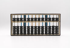 Antique abacus on white Stock Image