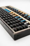 Antique abacus on white royalty free stock image