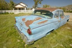 An antique abandoned 1955 Ford in front yard of house near Barstow, CA off of Route 58 Royalty Free Stock Photography