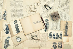Antique accessories, old letters and fashion drawings Royalty Free Stock Photography