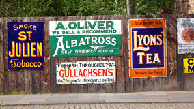 Antique Advertising Boards. BEAMISH, UK - JULY 27, 2012: Antique advertising boards at Beamish Museum, a world-famous open-air museum that tells the story of royalty free stock photography