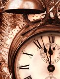 Antique alarm clock. Detail of antique alarm-clock in brown tone as New Year greetings royalty free stock photos