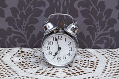 Antique alarm clock on table cloth Stock Photo
