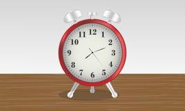 Antique alarm clock on a wooden desk royalty free illustration