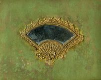 Antique album cover. With gold fan mirror/frame design and threadbare fabric. Grunge and wear intact Stock Image