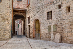 Antique alley in Spoleto, Umbria, Italy Royalty Free Stock Images