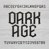 Antique alphabet vector font. Distressed type letters symbols and numbers on a wooden background. Royalty Free Stock Photos