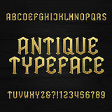 Antique alphabet vector font. Type letters symbols and numbers on a wooden background. Stock Photo