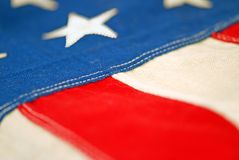 Antique American Flag. Hand sewn antique American flag with shallow focus on the stitching Royalty Free Stock Image
