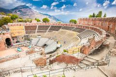 Antique amphitheater Teatro Greco in Taormina, Sicily. Italy.It is one of the most celebrated ruins in Sicily Stock Photo