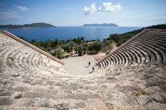 Antique ancient amphitheatre in Kash. Antique ancient amphitheatre in Kah overlooking sea and rocks view from top Royalty Free Stock Image