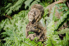 Antique ancient statue with moss Stock Photography