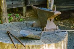 Antique Anvil, Tongs and Hand Shovel at a Blacksmith Shop. Hardy, VA – May 6th; Antique Anvil, Tongs and Hand Shovel at the Blacksmith Shop located at the stock photography
