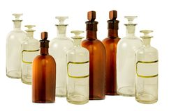 Antique apothecary bottles. Many vintage apothecary bottles on a white background royalty free stock images