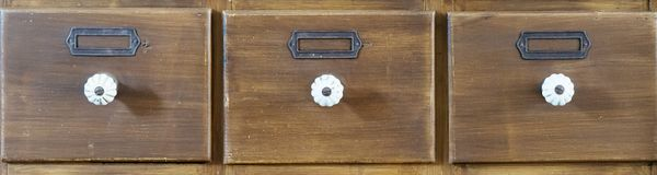 Antique apothecary wood closet with drawers. Close Up royalty free stock image