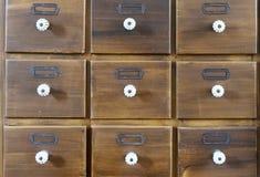 Antique apothecary wood closet with drawers. Close Up stock photos