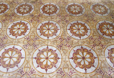 Antique arabic floor tiles. An image showing the beautiful middle eastern patterns formed by antique arab floor tiles in an arabian building interior.  Exotic Stock Photos
