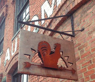 Antique archaeology Nashville store. Antique archaeology Nashville metal rooster sign Stock Photography