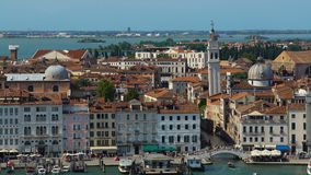 Antique architecture of Venice, view of buildings and tourists walking on bridge. Stock footage stock footage
