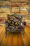 Antique armchair in the brick wall room Stock Image
