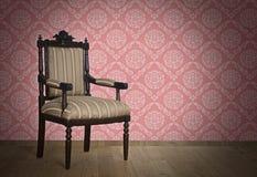 Antique armchair Near The Wall Royalty Free Stock Photos