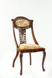 Antique Art Nouveau parlour chair with flowing curved lines Stock Image