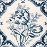 Antique Art Nouveau tile. An Art Nouveau original tile dating around 1890 with tulip flower design Royalty Free Stock Photo