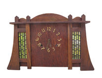 Antique arts and crafts table clock isolated. Royalty Free Stock Images