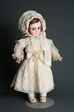 Antique authentic old bisque doll Stock Photography