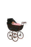 Antique baby carriage against high key background Royalty Free Stock Photos