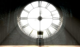 Antique Backlit Clock And Empty Chair. A 3D render of the attic room behind an antique tower clock brightly illuminated by the sun revealing an empty chair Stock Photos