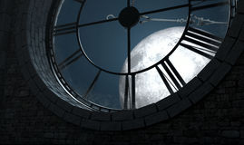 Antique Backlit Clock And Moon. A 3D render of the interior of the attic room behind an antique tower clock backlit and illuminated by a full moon at night Stock Photo