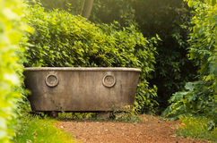Antique bath in garden Royalty Free Stock Images