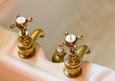 Antique bath taps or faucets Royalty Free Stock Photography