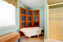 Antique bathroom interior with white bath tub Royalty Free Stock Photos
