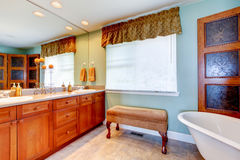 Antique bathroom interior with white bath tub Royalty Free Stock Photography