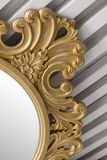 Antique beautiful rustic vintage gold mirror in white interior close up.  Stock Photo