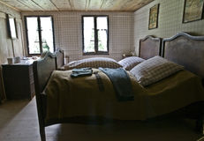 Antique bedroom. Bedroom of a very old european wooden house Royalty Free Stock Photos