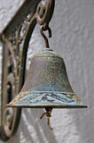 Antique Bell. An Antique Brass Bell Hanging From A Wall Royalty Free Stock Photo