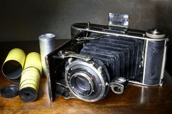 Antique bellows camera and original film Royalty Free Stock Image