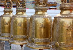 Antique bells in a buddhist temple of Thailand.  Royalty Free Stock Images