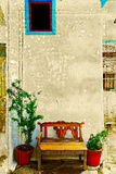 Antique bench against a wall. Stock Photography