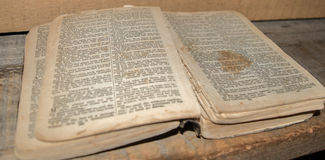 Antique Bible. Open Bible on shelf - much used Royalty Free Stock Photo