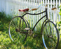 Antique Bicycle. Bicycle Leaning Against a White Picket Fence Stock Photos
