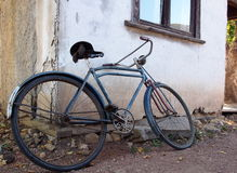 Antique Bicycle Against A White Building Royalty Free Stock Images